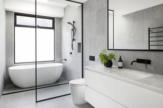 The couple used Phoenix tapware, tiles and marble benchtops in the wet areas of all the bathrooms.