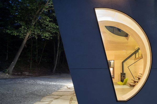 A curved window gives a glimpse into the Ex of In House's interior.