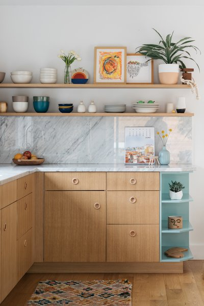 The kitchen is a mix of IKEA cabinets, custom white oak, and painted doors.