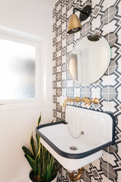 The powder room features Teselle tiles.