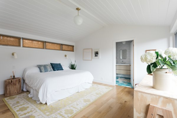 One of the bedrooms features a Cedar & Moss pendant and pillows by Block Shop Textiles.