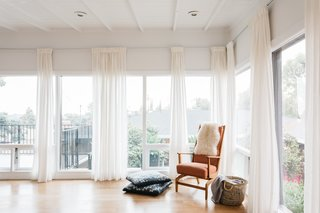 Floor-to-ceiling windows bring plenty of light into the master bedroom.