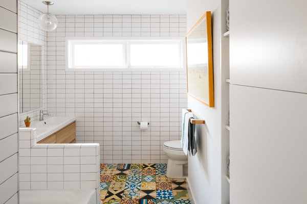 Cement tiles feature prominently in the master bathroom, powder room, and area around the fireplace.