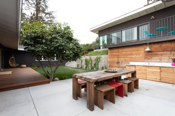 The couple added sliding doors so that the deck could become an extension of the living area.