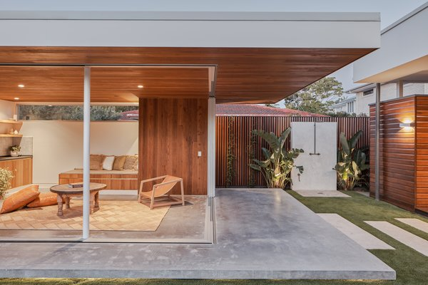 The studio's program is divided between a pergola, an outdoor refuge, and an entirely self-contained separate granny flat.