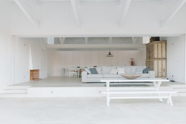 The living area opens up to the deck for a fully immersive, indoor/outdoor experience.