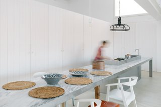 The dining area is an extension of the aluminum kitchen.