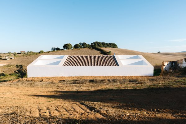 Roof Cut-Outs in This Portuguese Home Draw in Light and Air