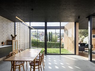One challenge was connecting the heart of the building to the backyard on the steep slope, but avoiding making the home feel like two distinct parts.