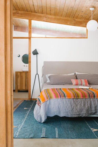 A Duxiana king-sized platform bed and a Mañana lamp in the master bedroom.