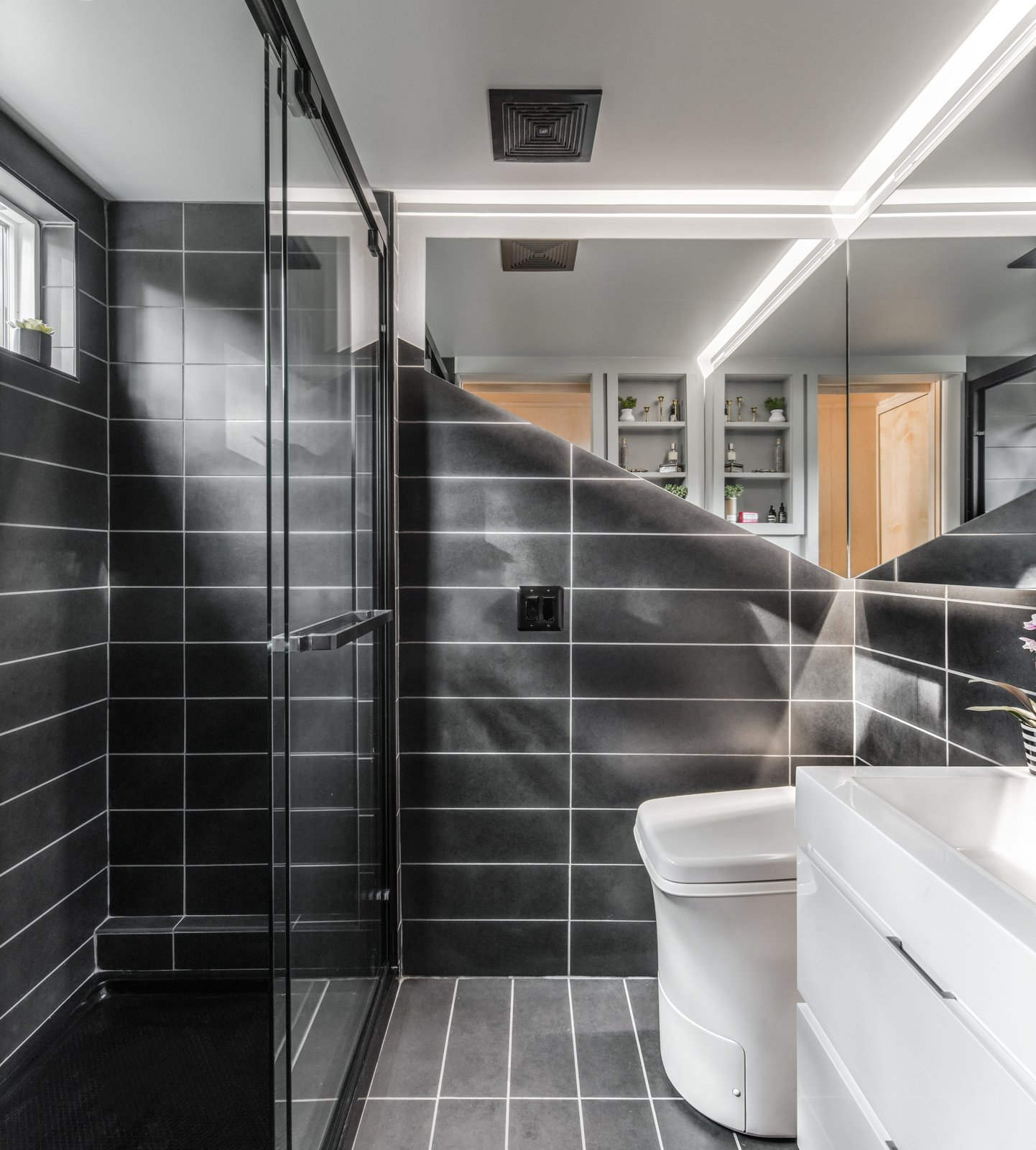 Orchid Tiny House bathroom with Cinderella incinerator toilet