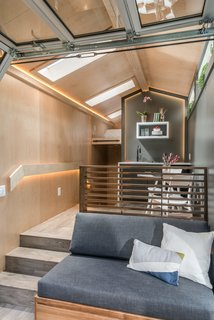 Inspired by Scandinavian and Japanese aesthetics, the modern Orchid tiny house features an interior clad in three-quarter-inch maple plywood.