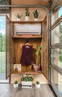 The air conditioning unit is concealed within a closet.