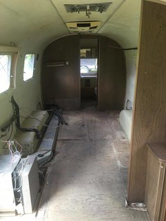 Before: The old bedroom was dark, and a bathroom took up space at the rear of the trailer.