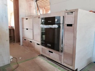 Before: A full-sized oven fits into the kitchen cabinetry.