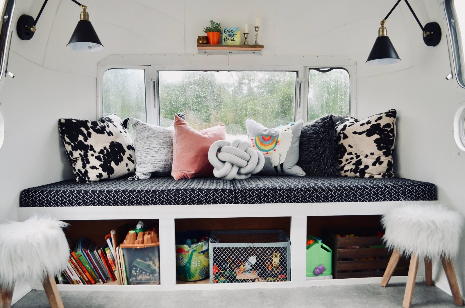 After: Renovated Airstream Sovereign seating with shelving