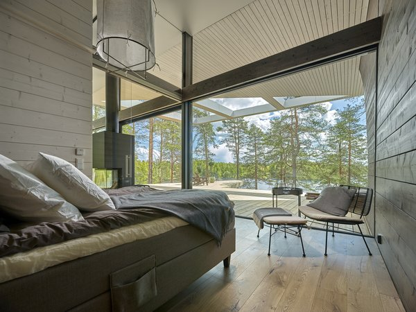 The master bedroom enjoys lake views.