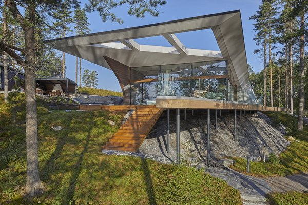 The Wave House seamlessly combines solid timber with glass.