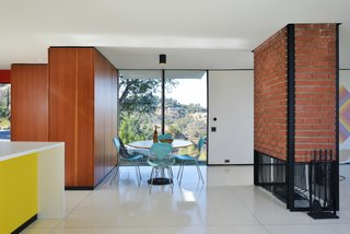 The renovation restored the original brick and steel fireplace.