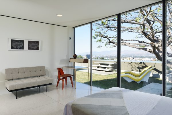 A bedroom that looks out to the pool.