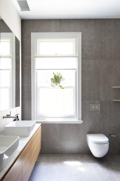 The bathroom is sleek and understated.