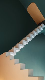 The second floor and stairs are made of steel cladded with painted plywood or gypsum board.