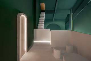 Maze juxtaposes pink and green. The walls, floors, and ceilings are painted concrete.
