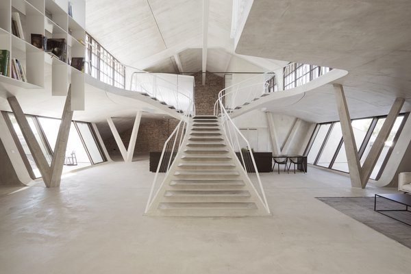 This Loft With a Stunning Staircase Looks Like a James Bond Villain's Lair
