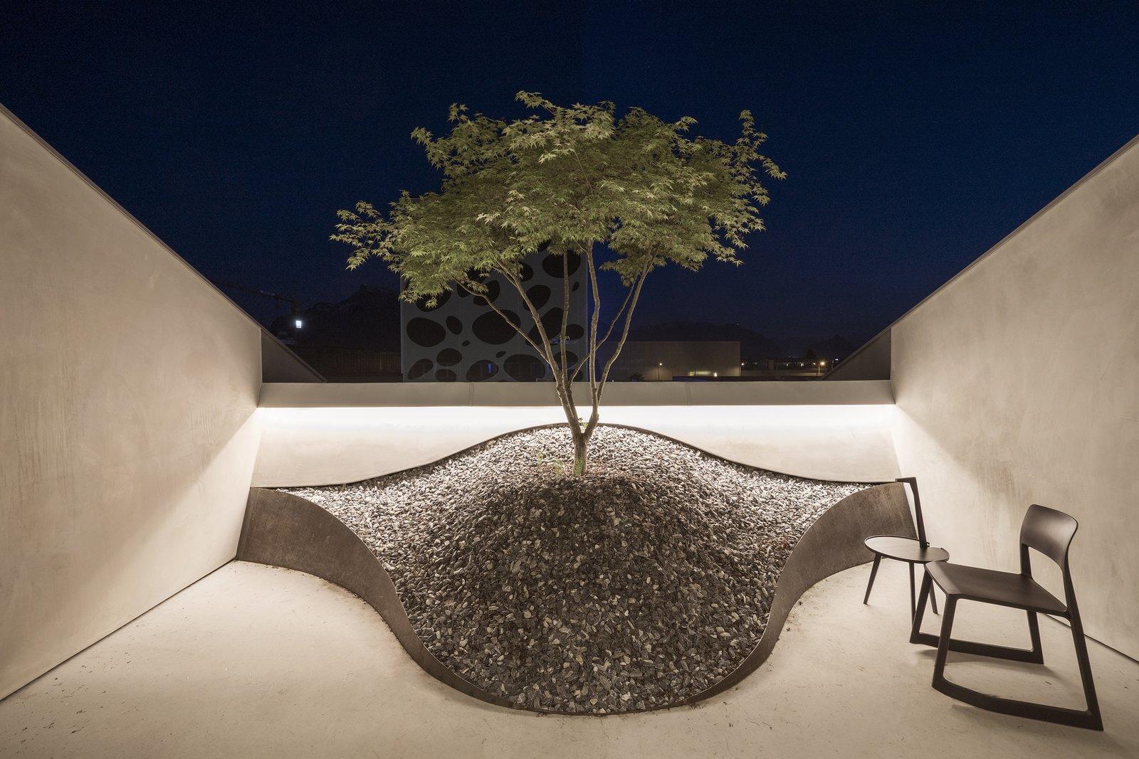 Loft Panzerhalle balcony with rock garden