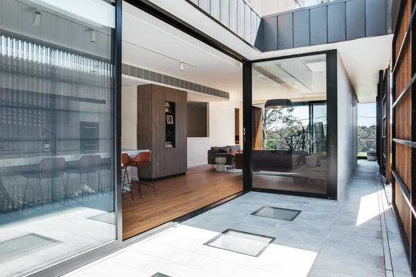 Venture Plank engineered timber flooring in the Oak Quantum finish run throughout the home.