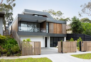 """The interlocking panel fascias look a little like the Nokia Snake game folding and raking between the two properties and sandwiching the layers of the house within them,"" says Jost."