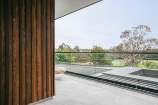The burnt ash exterior timber cladding by Woodform Architectural features alternating thicknesses.