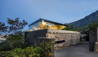 An Inverted Pyramid Roof Tops This Stately Retreat in Cape Town