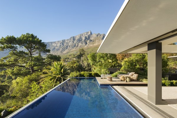 The infinity pool seems to stretch into lush views.