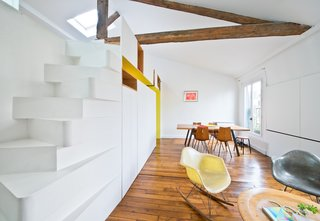 """The staircase is a great space saver, and we worked to give it an unusual presence,"" says Delauney. ""It seems challenging to climb to some, even though it is actually very comfortable. This helps define the space on the mezzanine as tucked away from the rest of the apartment, harder to reach, and private."""