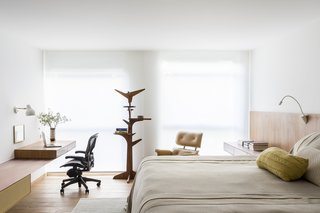 The master bedroom features a Pedro Useche coat rack and an Eames chair.