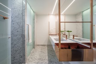 Di Marmore marble floors and walls clad the master bathroom.