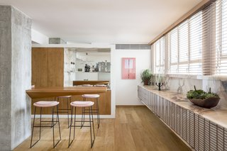 The dining area features marble countertops designed by Pascali Sermerdjian.