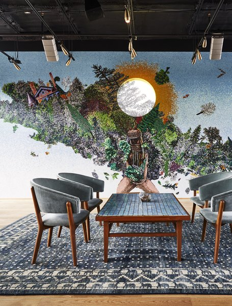 "The ""Wild Days"" space is defined by a black painted ceiling and a massive custom mosaic."