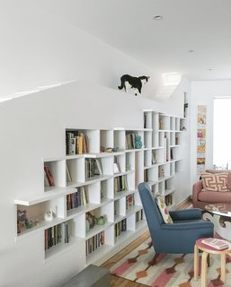 Living Room, Stools, Bookcase, Recessed Lighting, and Chair This Brooklyn home has a bookcase with a built-in catwalk.