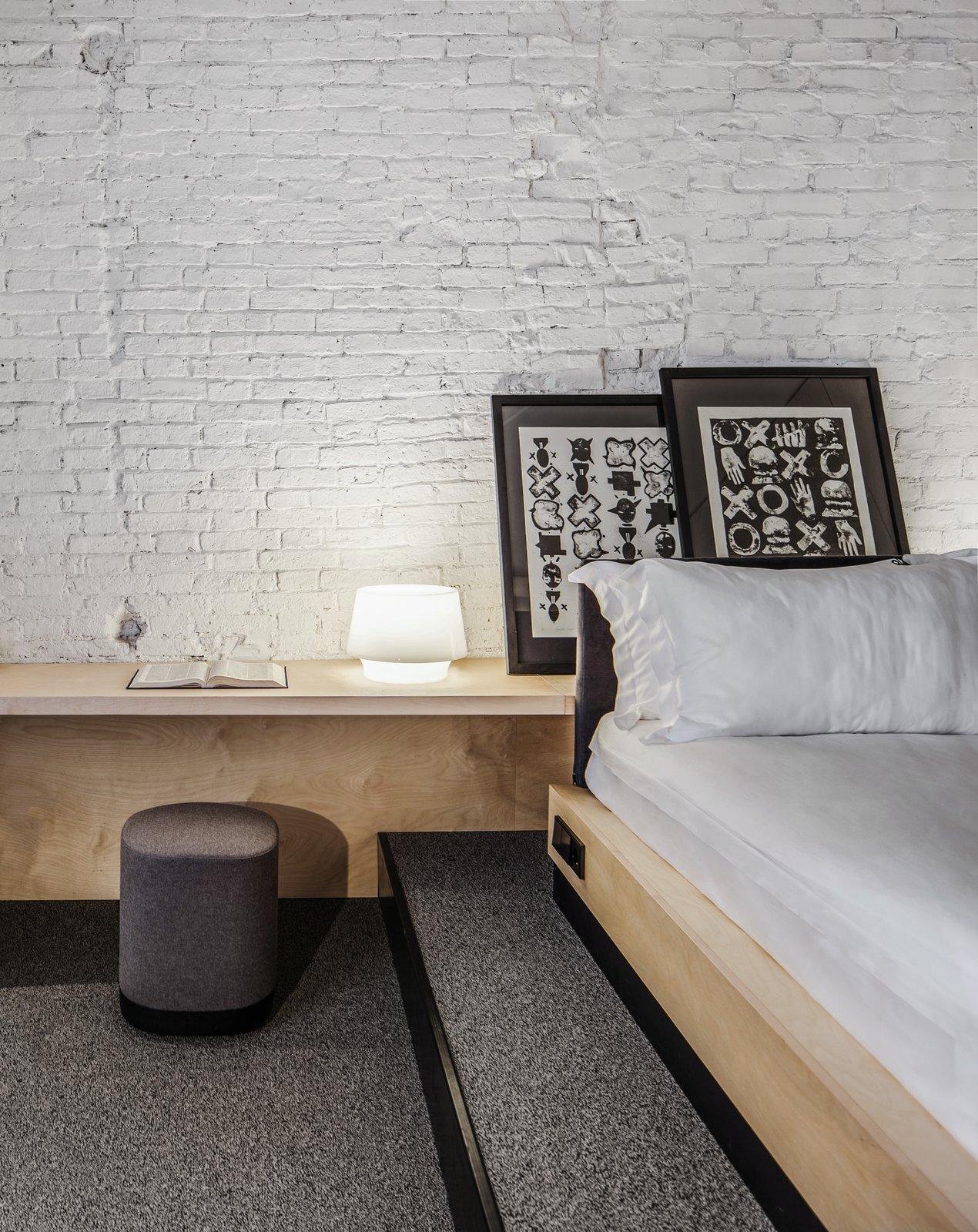 Bursa Hotel bedroom with whitewashed brick walls