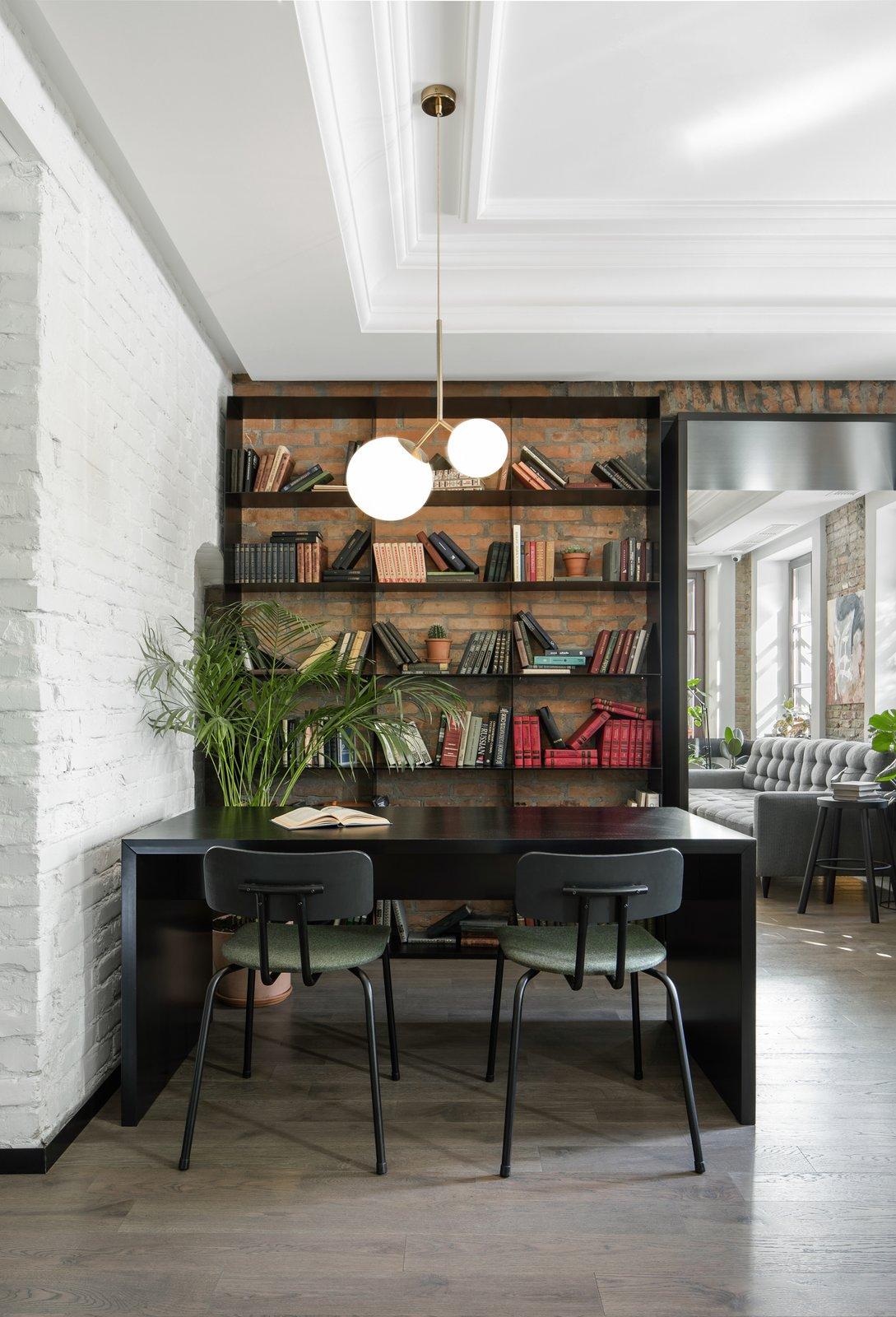 Bursa Hotel lounge with bookshelf and whitewashed brick walls