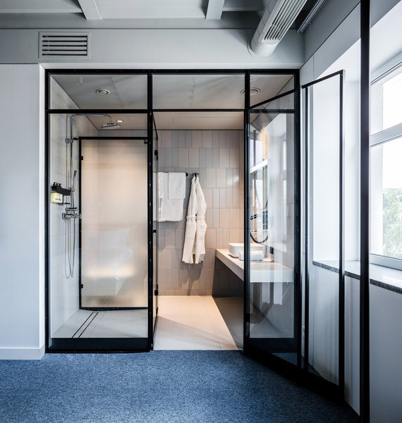 One of the bathrooms is conceived as a modern glass box.