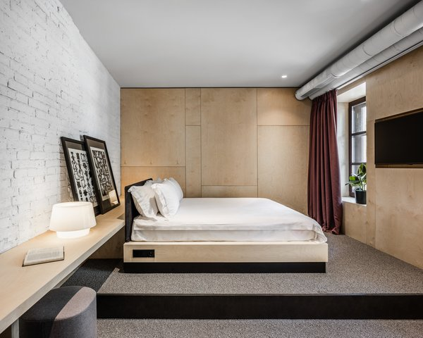 This guest suite features whitewashed brick walls.