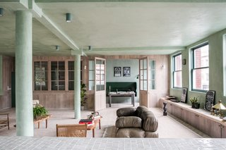The living room features an olive-green Camaleonda sofa by Mario Bellini.