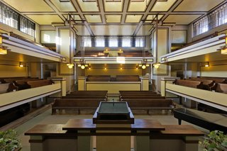 Unity Temple, interior view showing eastern alcove of Unity House, and balcony above.