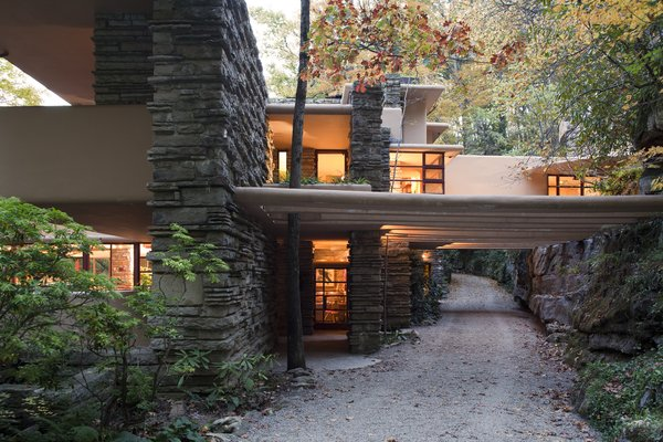 Fallingwater, view of entry (center) with trellis beams extending across drive.