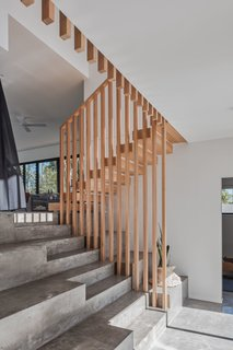 The concrete stairs and burnished concrete floors throughout are complemented with Tasmanian Oak stair treads and balustrade details.