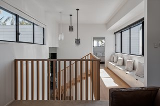Upstairs, the private spaces comprise four bedrooms and a separate lounge.