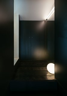 An all-black dressing room.